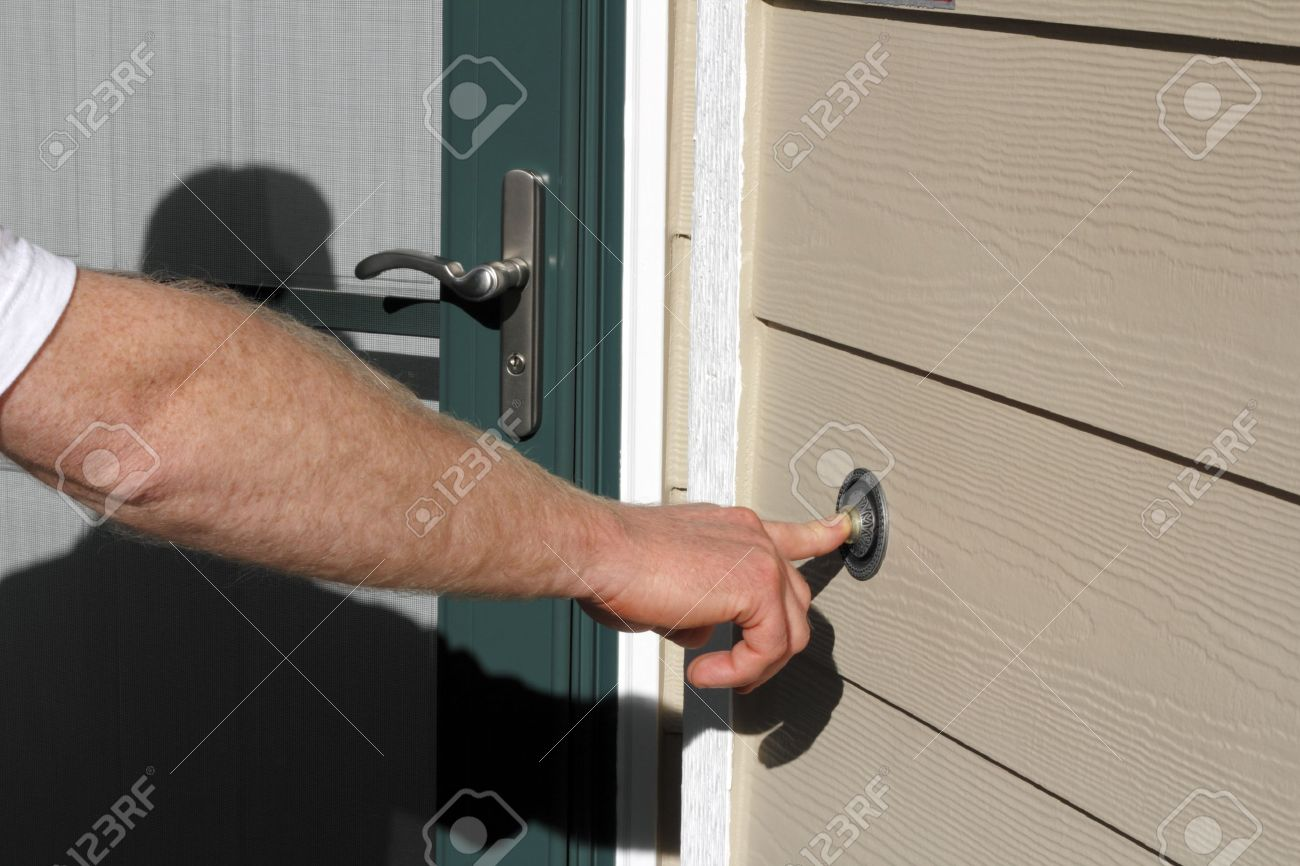 Right hand of a man ringing the front doorbell of a home. Stock Photo - 10740117
