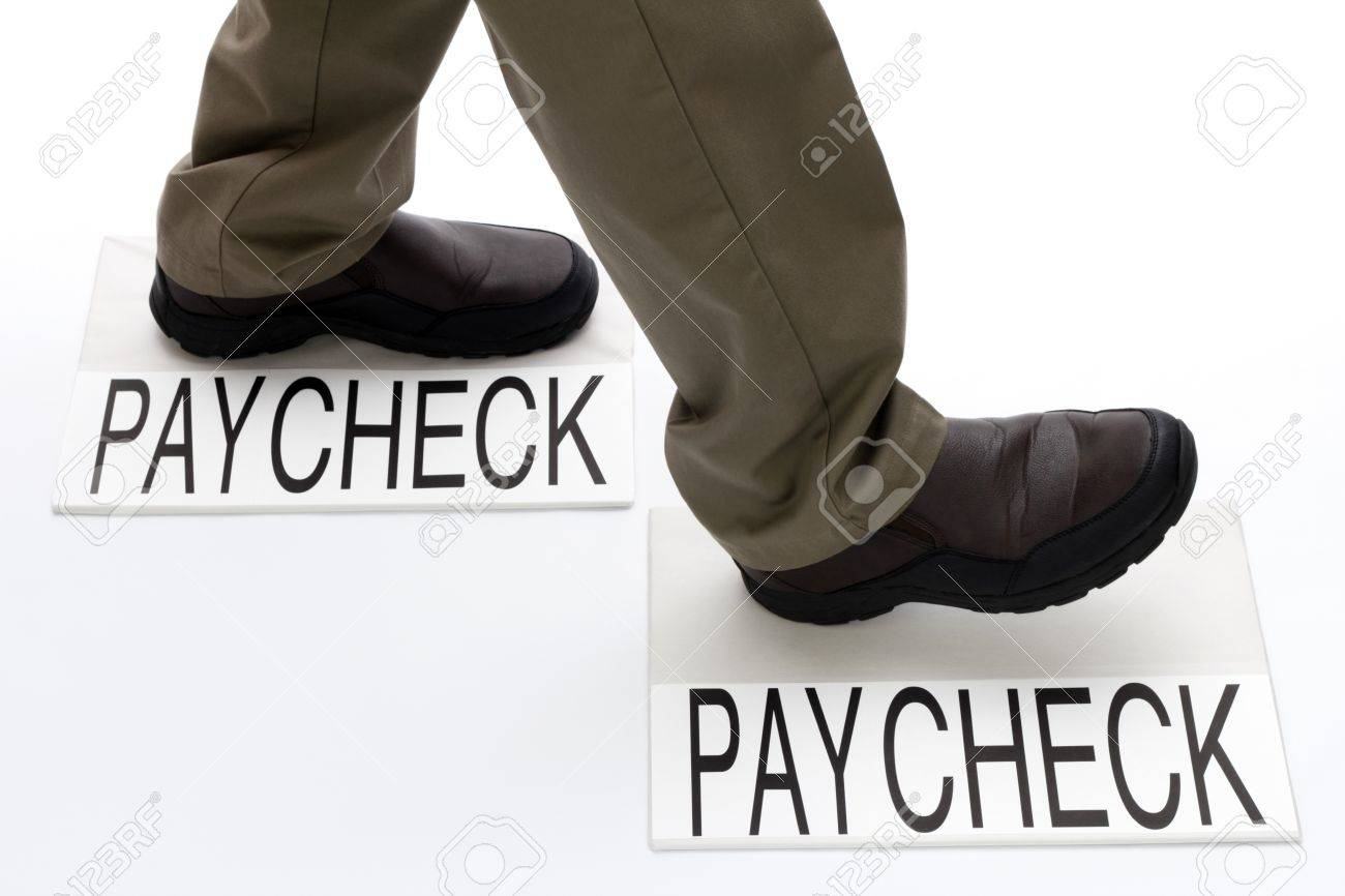 Person stepping from one paycheck to another paycheck. Stock Photo - 10878801