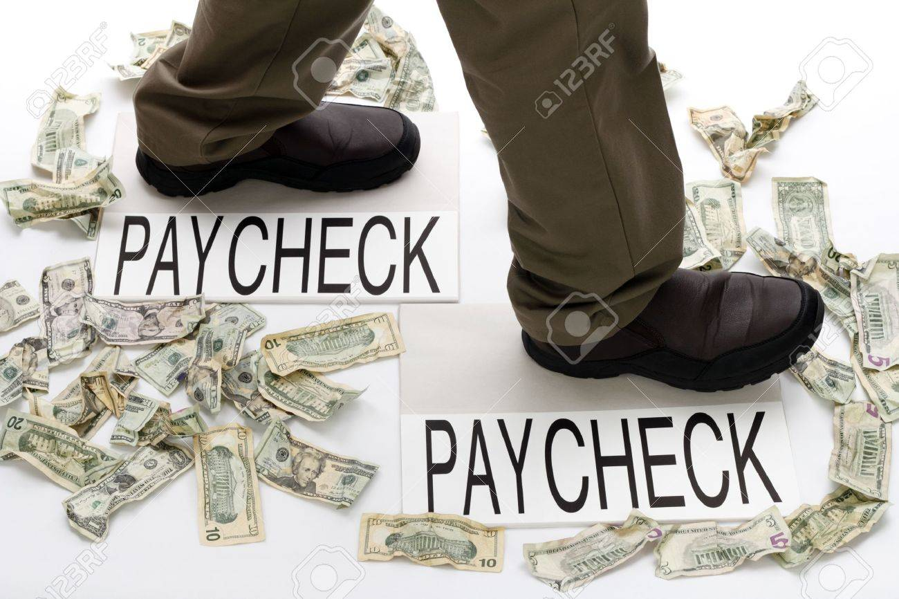 Male legs walking from one paycheck to another with crumpled money scattered about on the floor. Stock Photo - 10878799