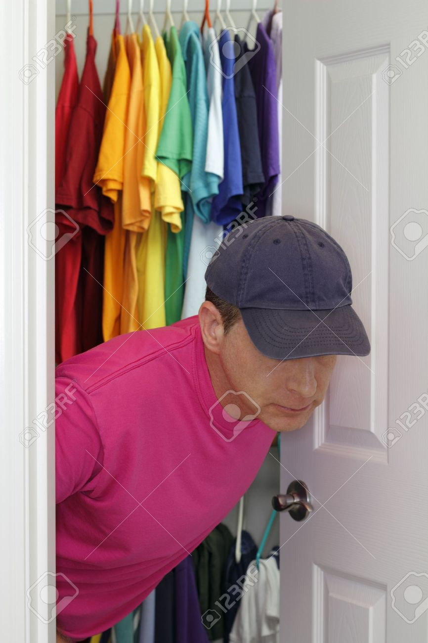 Older Gay Man Coming Out Of The Closet. Stock Photo   12393841