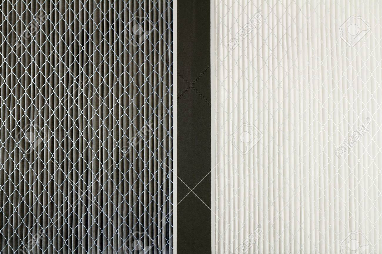 Close up side by side comparison of a dirty gray home air filter next to a clean white house furnace air filter. Stock Photo - 12394011