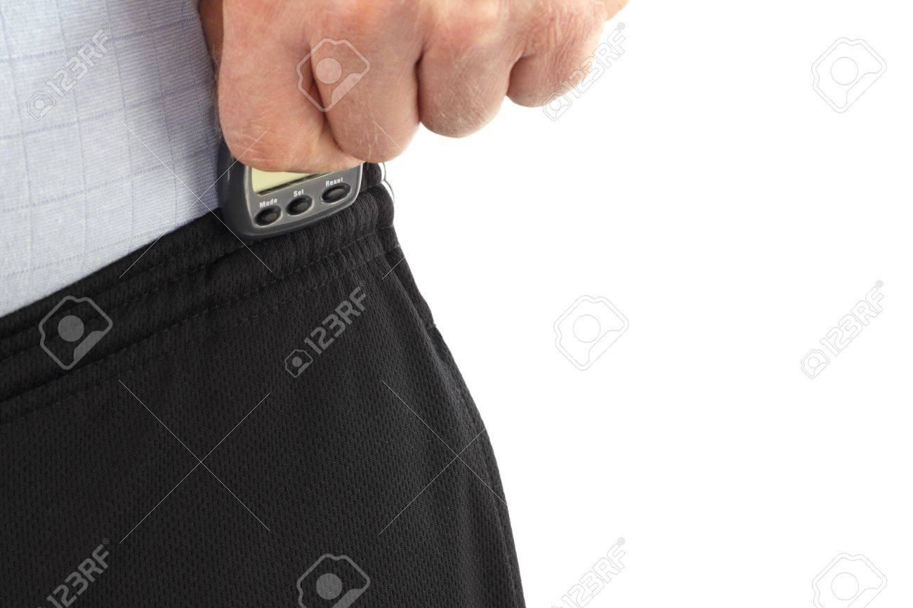 Male hand attaching a pedometer to his sweat pants in order to count the steps he will take on his daily walk. Stock Photo - 12391049