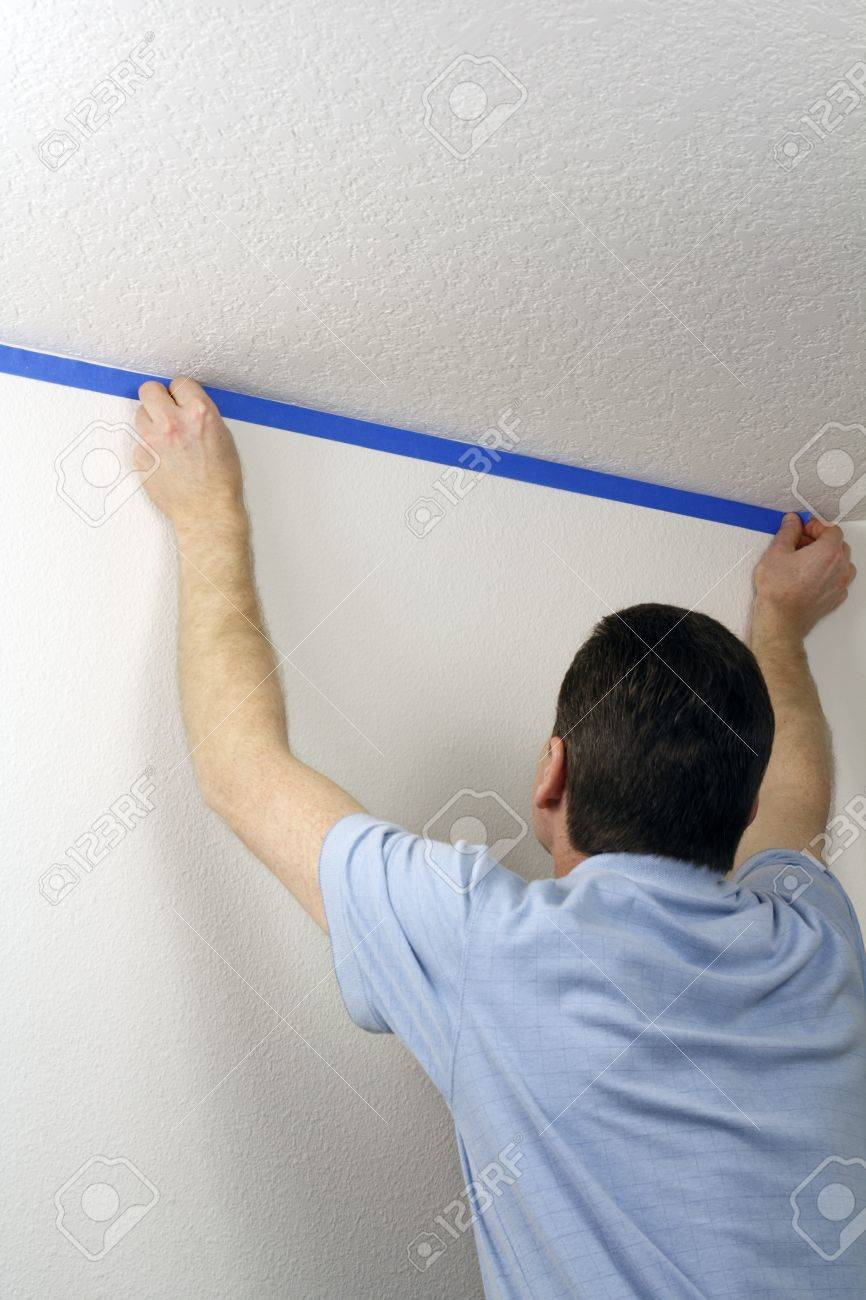 Adult male pressing blue painter Stock Photo - 12393997