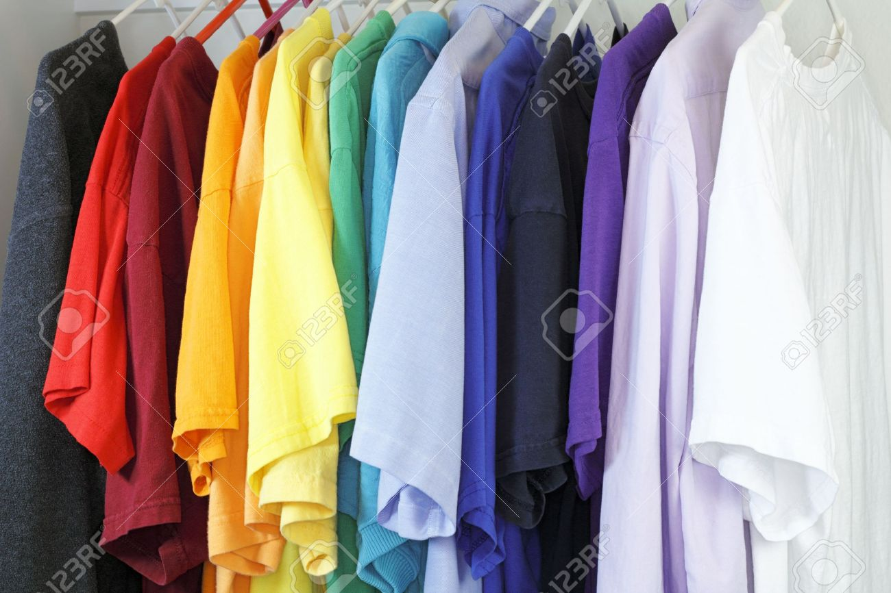Variety of shirts for a man to wear in a many different colors and styles hanging in a closet. Stock Photo - 12394012