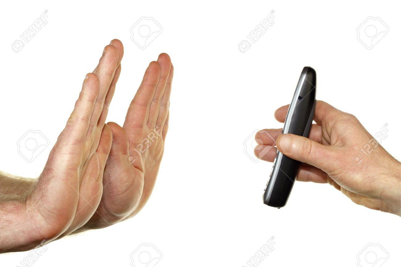 Two adult male hands on left raised up in a stop gesture refusing a call that Stock Photo - 12391046