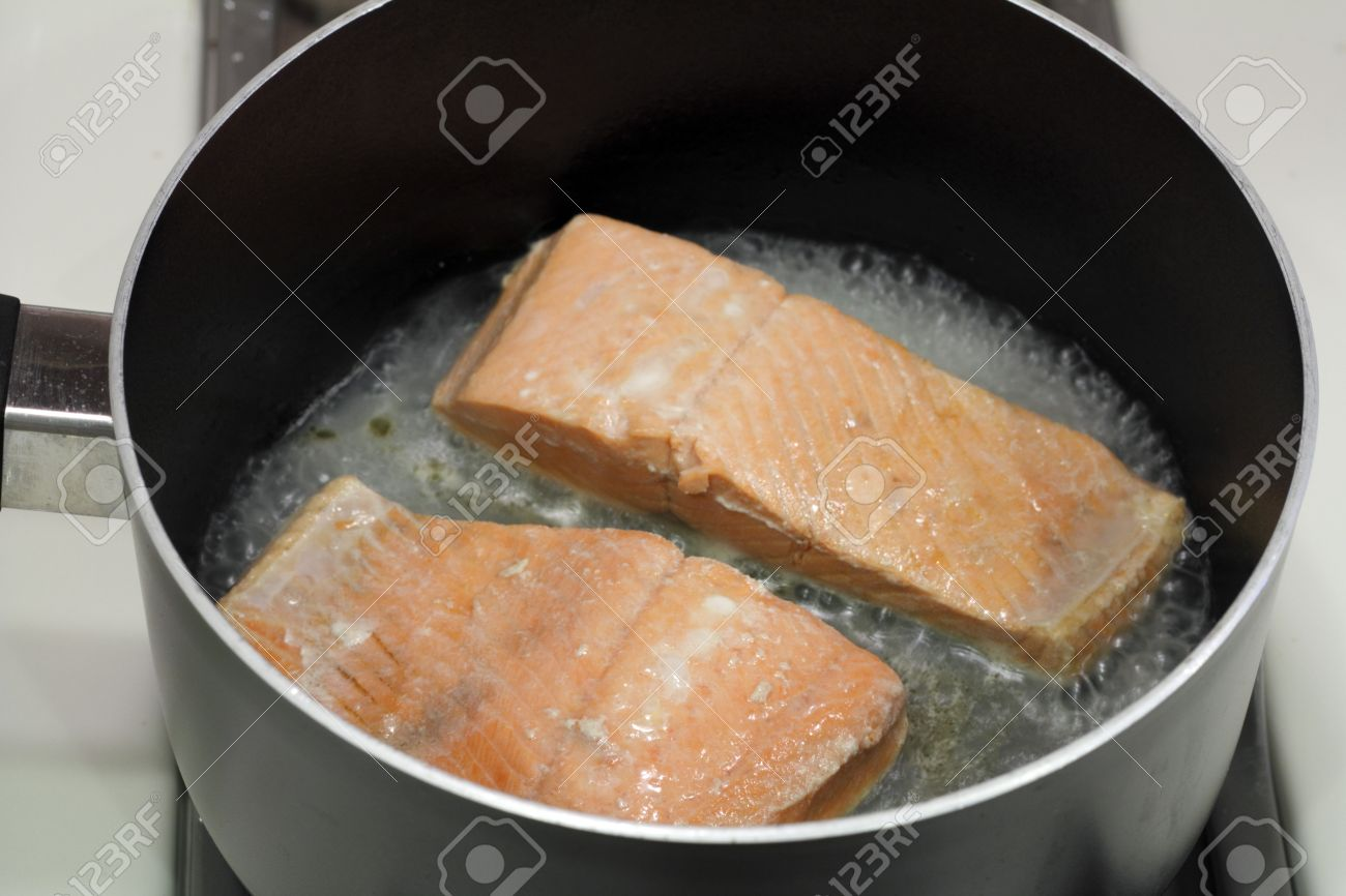 A Couple Of Wild Salmon Fillets Being Cooked In A Small Amount Of Water In  A A How To Grill Chicken On Stovetop