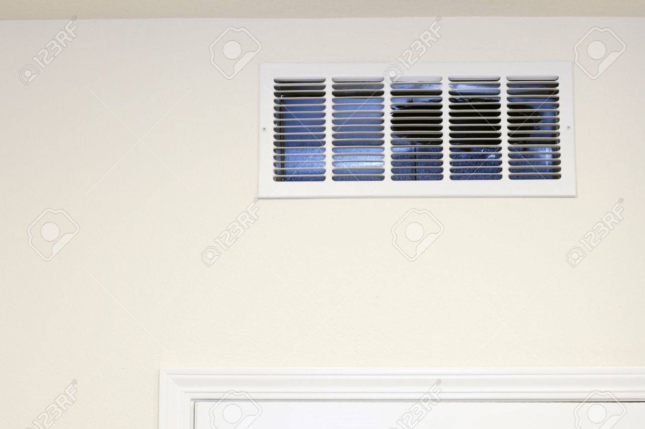 Return air vent on a kitchen wall above a door Stock Photo - 14706802