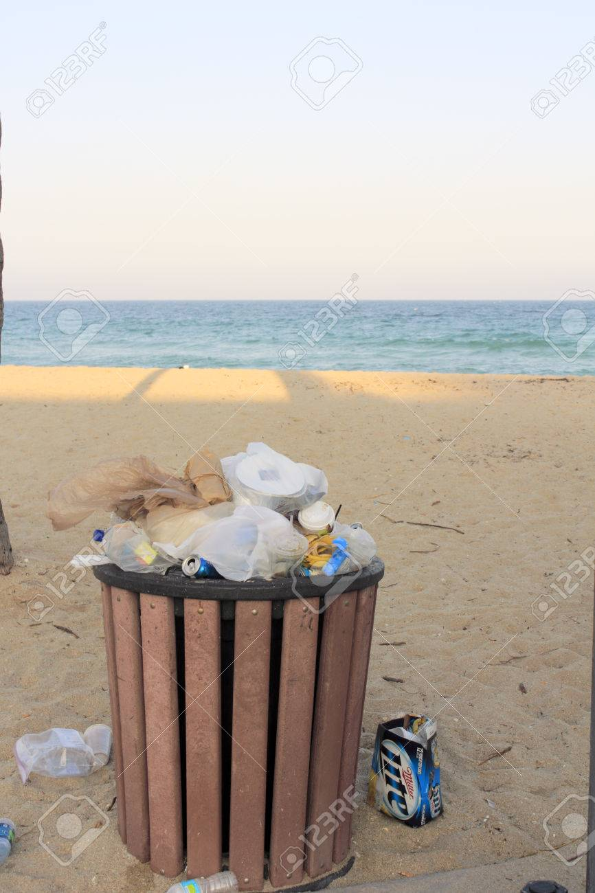 FORT LAUDERDALE, FLORIDA - MARCH 23, 2013  Refuse over flowing the public receptacle on a public beach near Sunrise Boulevard during spring break in late afternoon  Stock Photo - 25140858