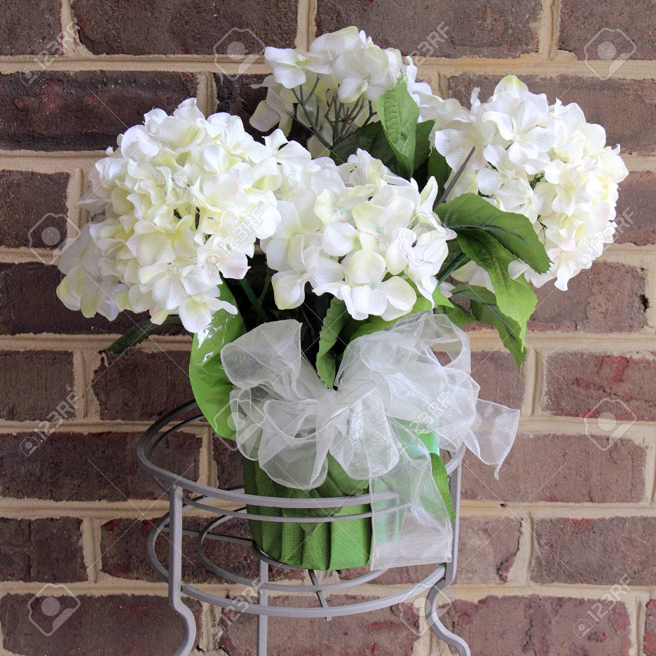 Beautiful But Fake White Hydrangea Flowers Plant In A Metal Plant