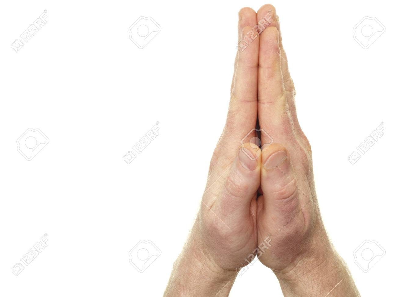One caucasian adult man with his hands placed together in prayer in front of an isolated white background. Male hands put together in a sign of praying closeup on white. Stock Photo - 55427276
