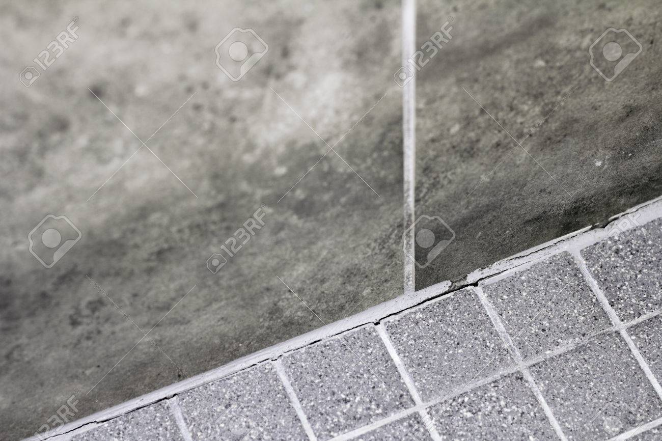 Gray tile grout in a home shower that has broken apart and needs gray tile grout in a home shower that has broken apart and needs repair cracked dailygadgetfo Choice Image