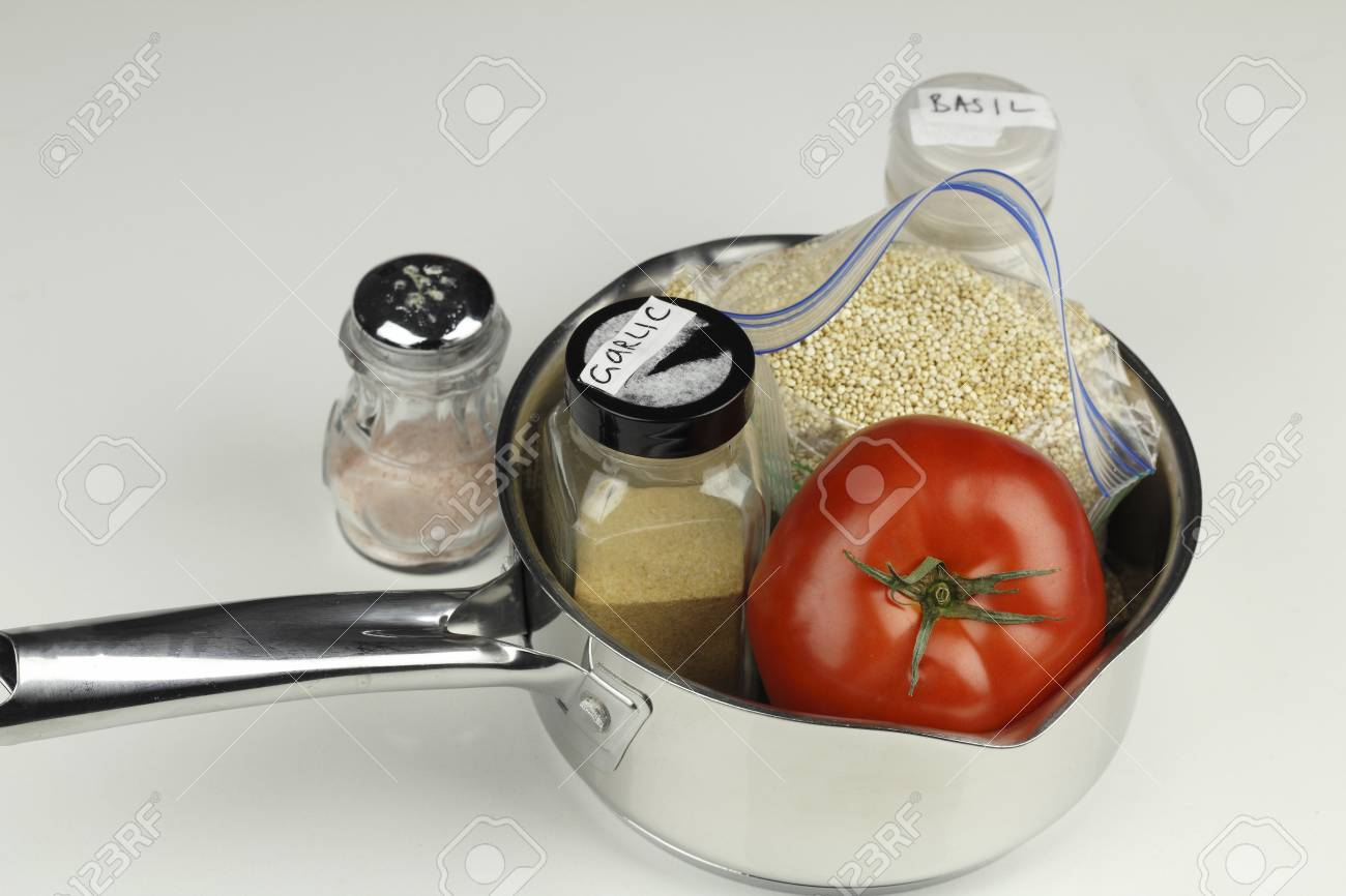 Gathered with a pan is tomato, garlic powder, white quinoa, basil and pink salt. Ingredients of vegetables, white organic quinoa and pink salt with a saucepan. Stock Photo - 75936523