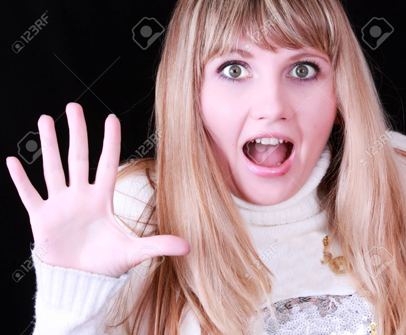 Young surprised woman on black background Stock Photo - 6115028