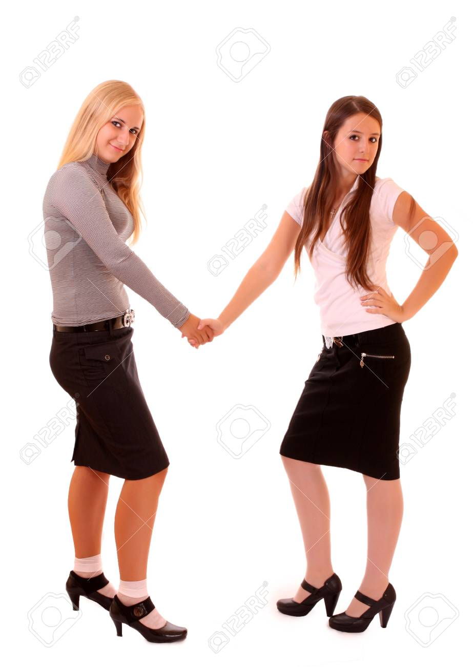 Two businesswomen shaking hands isolated on white Stock Photo - 6580581