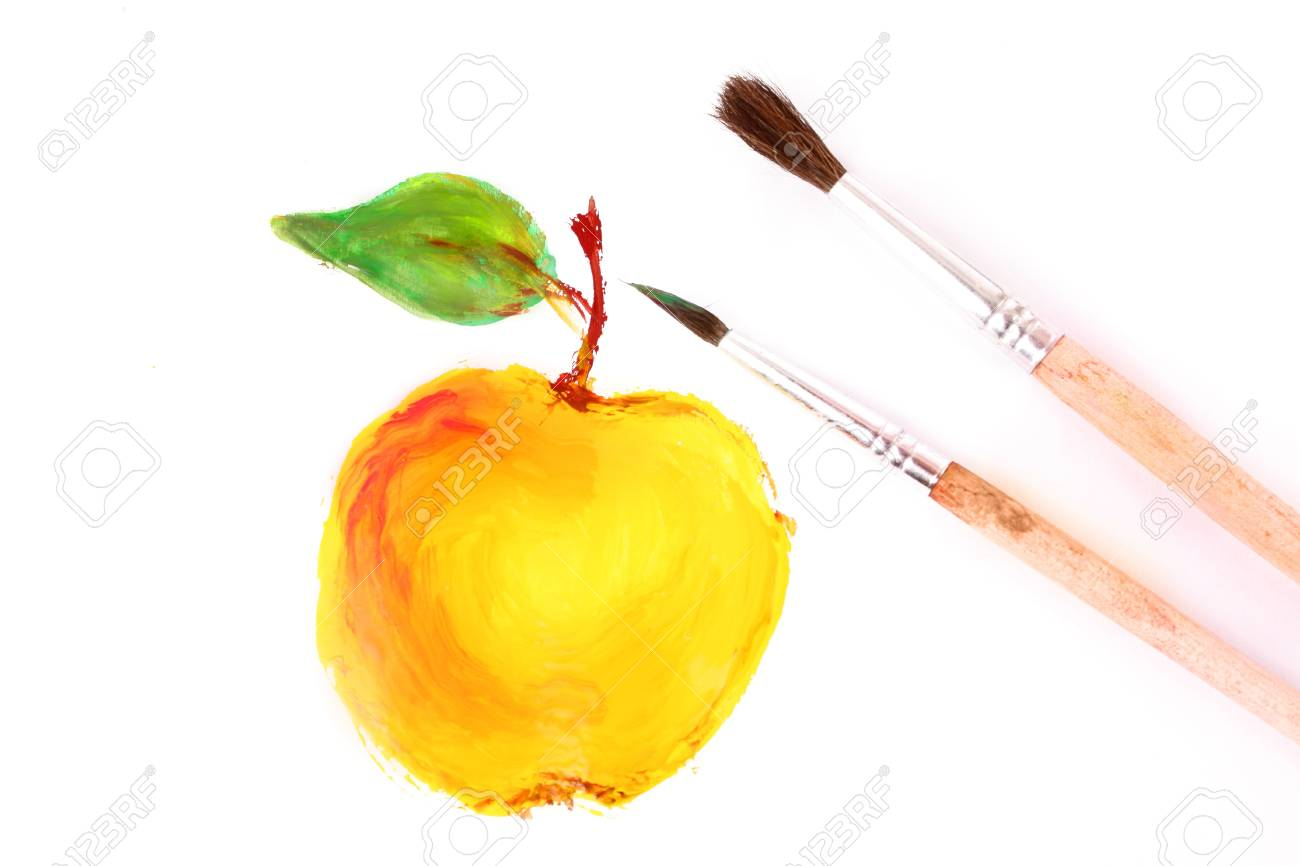 Painted yellow apple and brushes isolated on white Stock Photo - 8641134