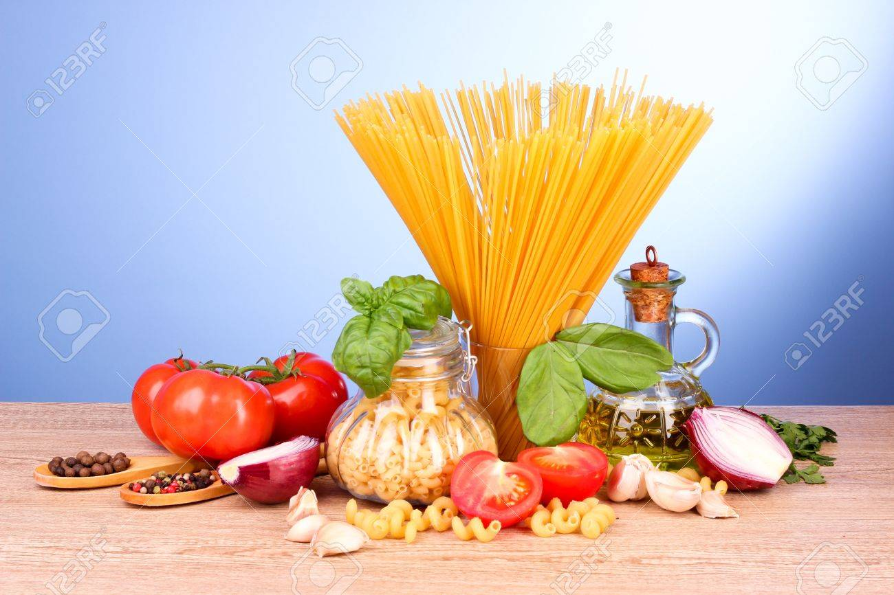 spaghetti with garlic, onion, spices  and basil on a yellow background Stock Photo - 9516805