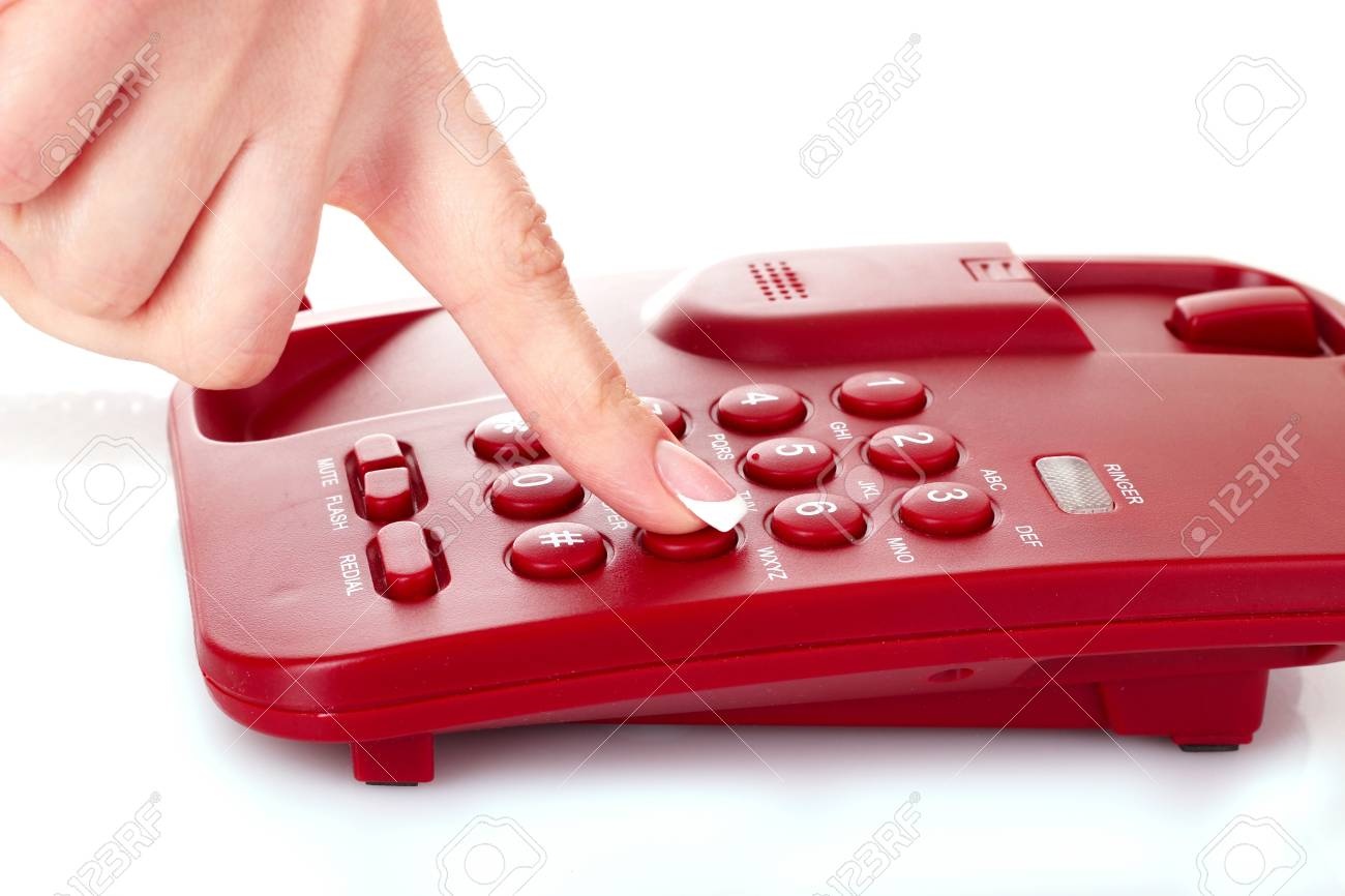 Dialing on the red phone Stock Photo - 9549905