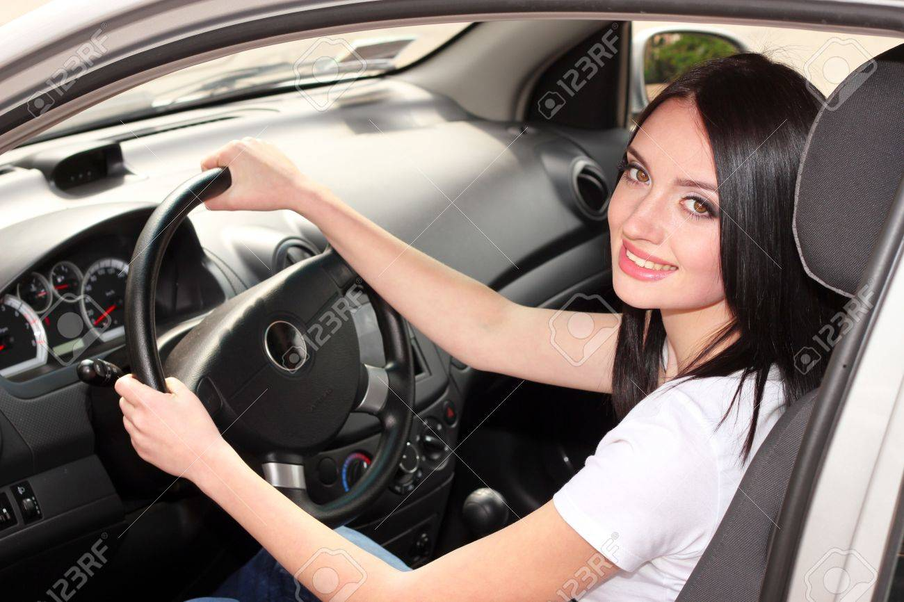 young brunette woman in new car Stock Photo - 9784554