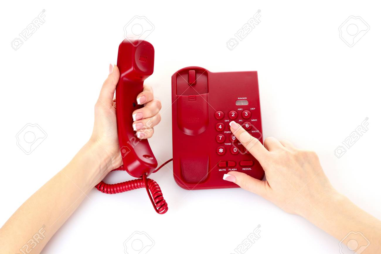 Dialing on the red phone Stock Photo - 9714858