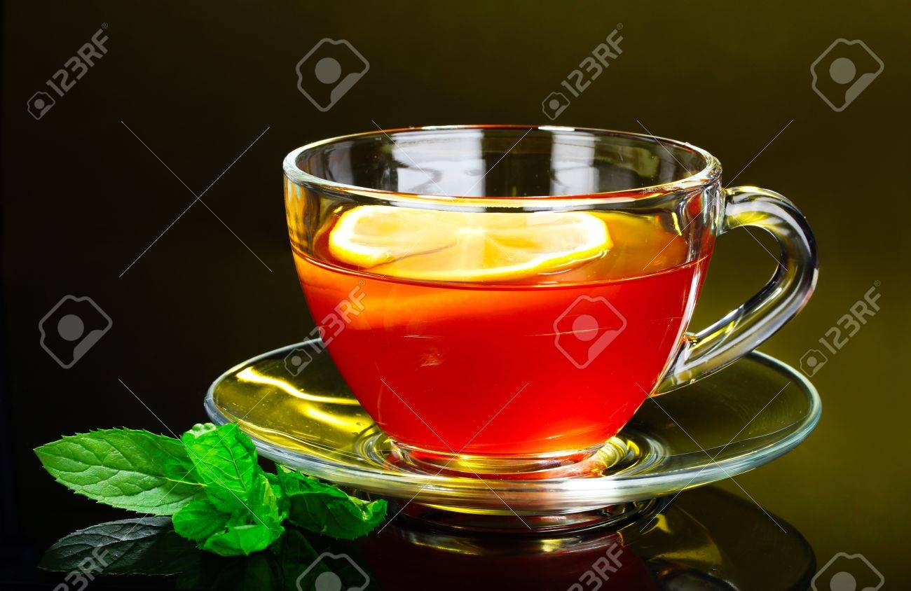 nice cup of tea and mint on yellow background Stock Photo - 9979710