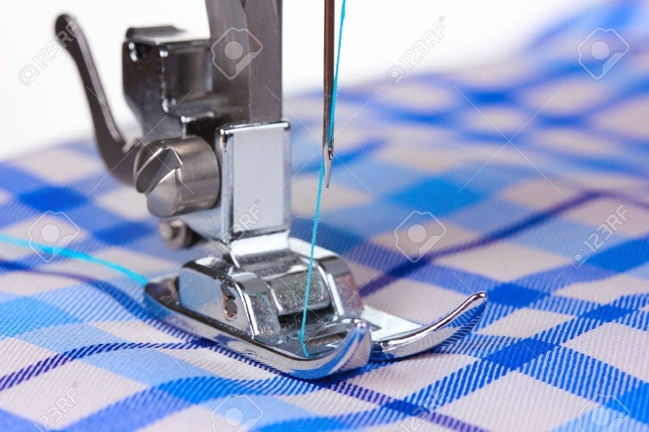 sewing machine and blue fabric Stock Photo - 10394978