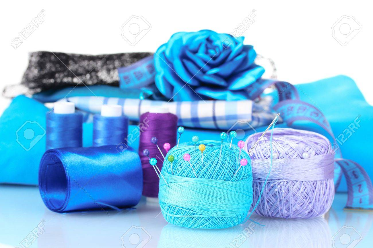 Bright Blue Yarn Fabric Satin Ribbon And Measuring Tape Isolated