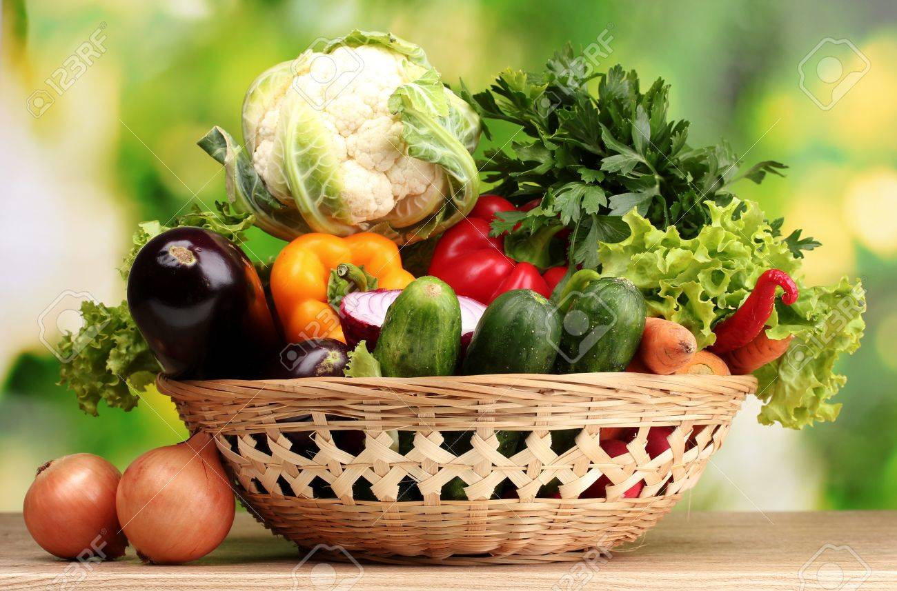 Delicieux Fresh Vegetables In Basket On Wooden Table On Green Background Stock Photo    10754080