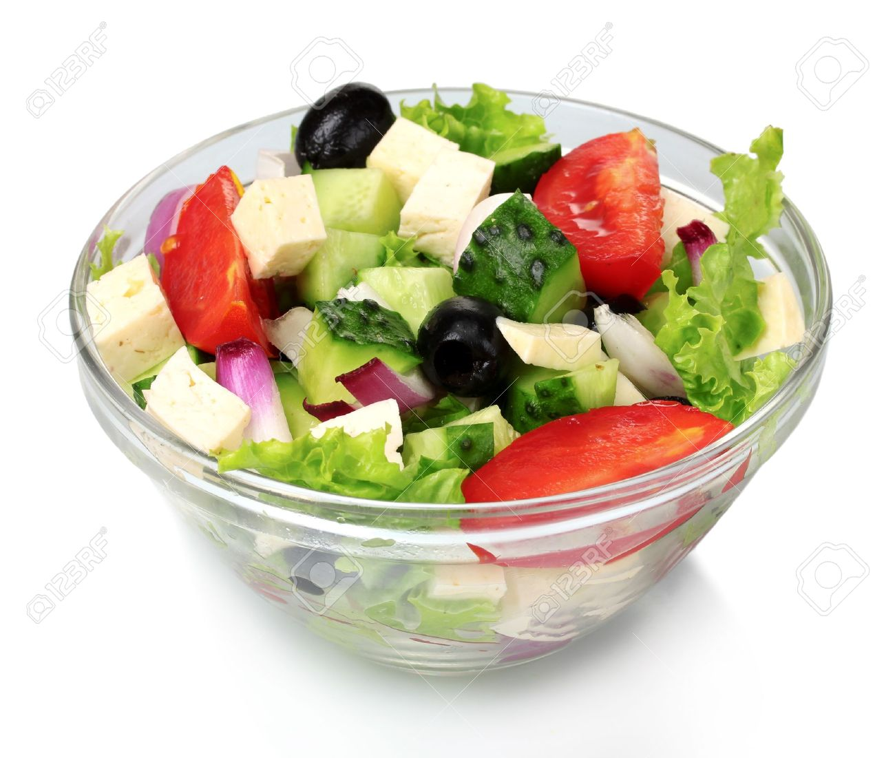 Tasty greek salad in transparent bowl isolated on white Stock Photo - 10752709