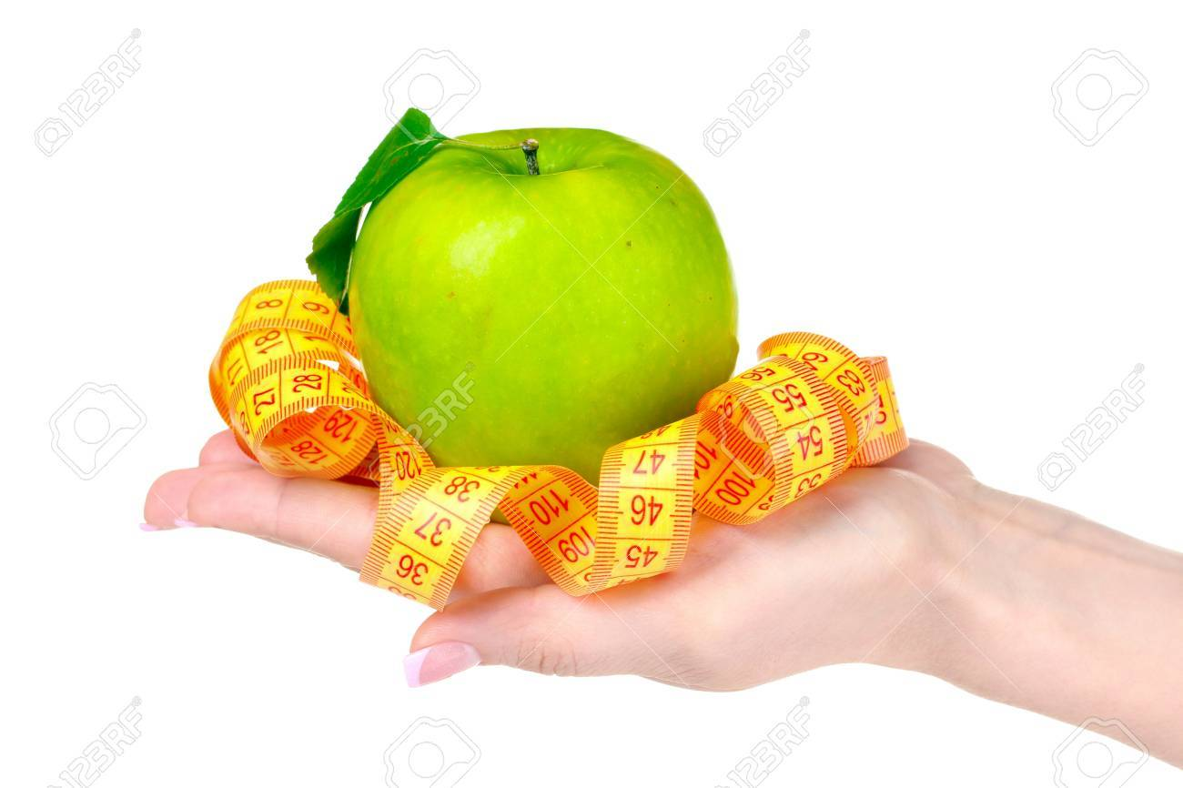Woman hand with apple and measuring tape on it isolated on white Stock Photo - 10817671