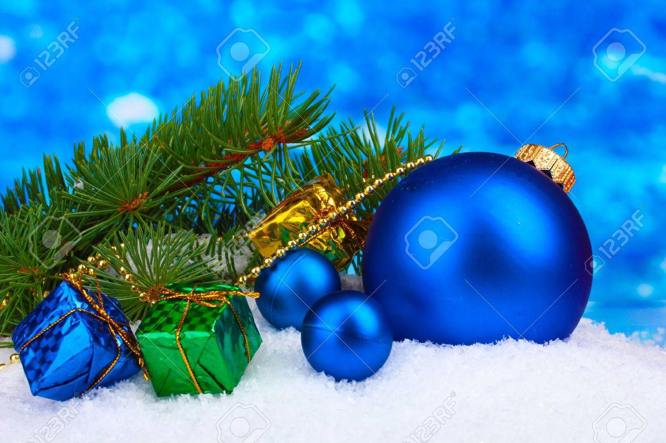 Christmas ball and toy with green tree in the snow on blue Stock Photo - 11407577