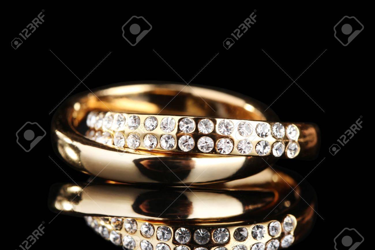 Golden ring on black Stock Photo - 11517139
