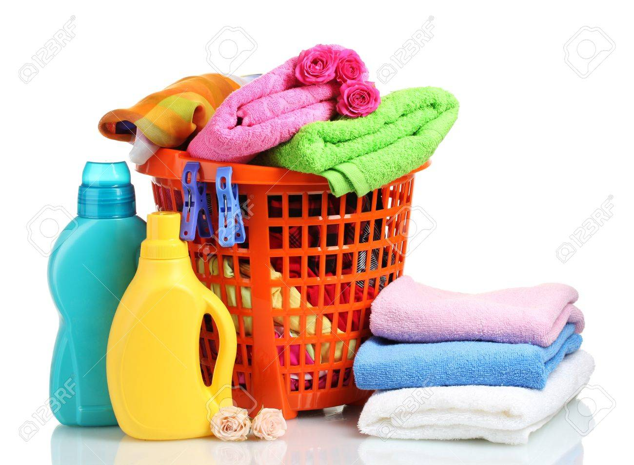Clothes with detergent in orange plastic basket isolated on white Stock Photo - 11517403