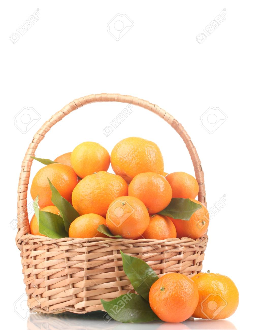 tangerines with leaves in a beautiful basket isolated on white Stock Photo - 12020547