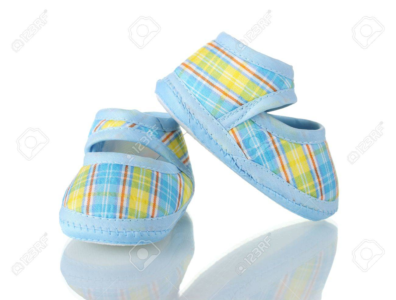Blue baby shoes isolated on white Stock Photo - 12021556