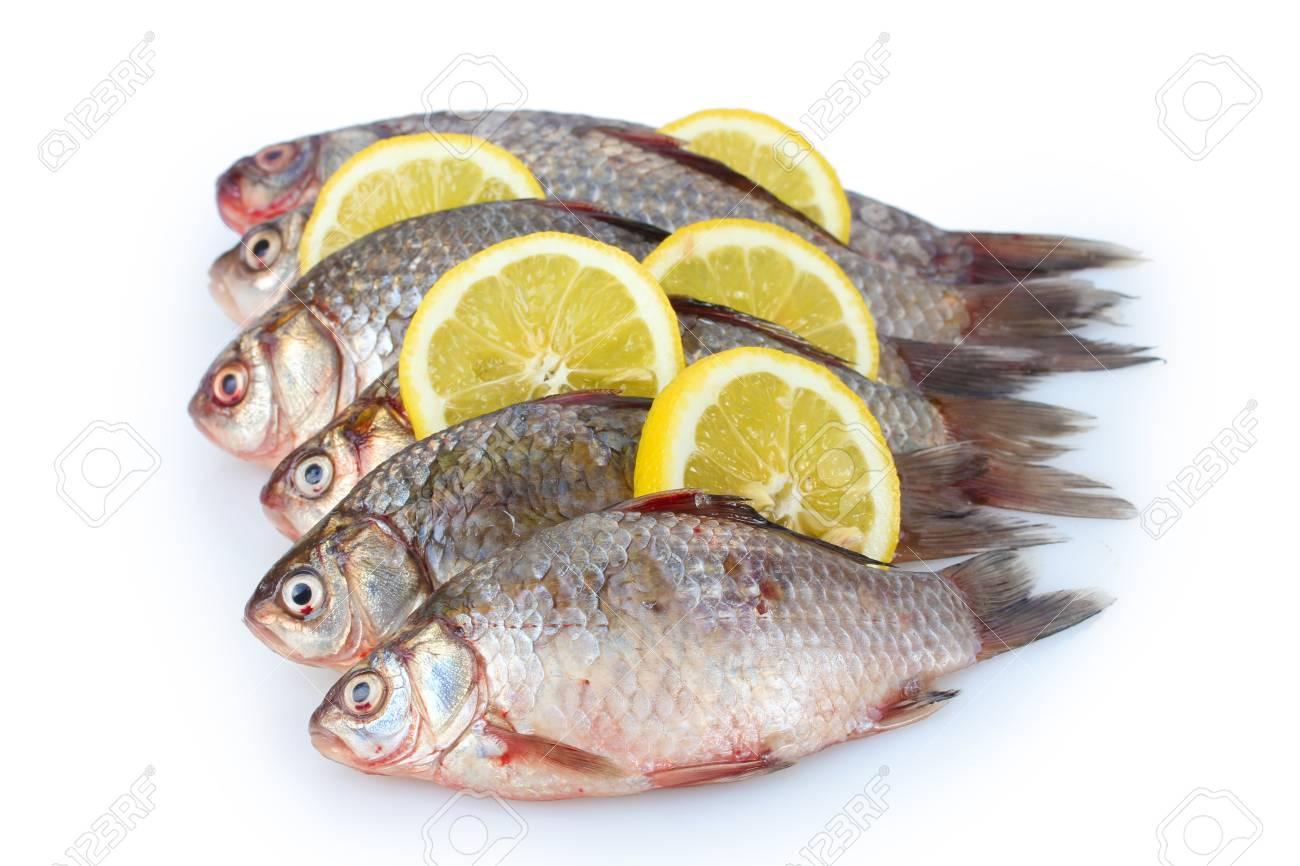 Fresh fishes with lemon isolated on white Stock Photo - 12564397