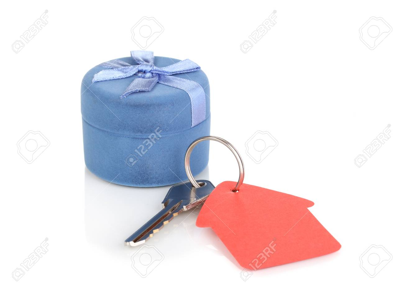 Key with house-shaped charm and box isolated on white Stock Photo - 12564131