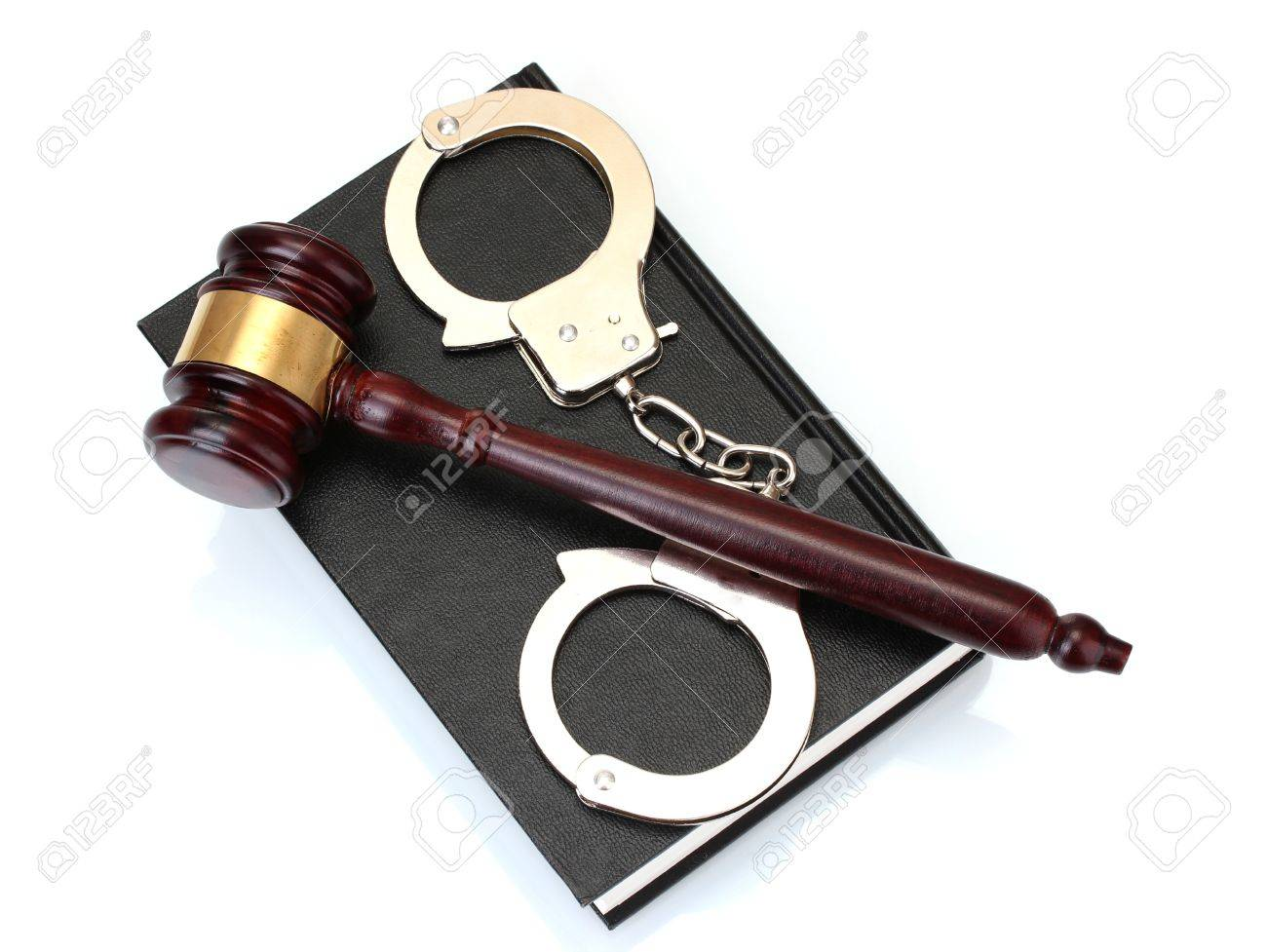 wooden gavel, handcuffs and book isolated on white Stock Photo - 12664365