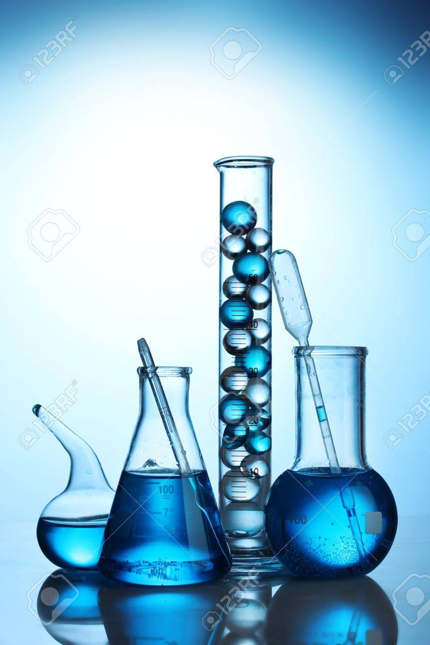 Test-tubes with blue liquid on blue background Stock Photo - 12664548