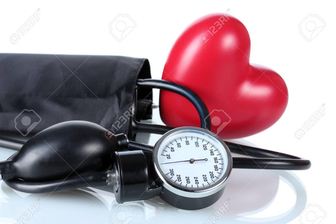 Black tonometer and heart isolated on white Stock Photo - 12664565