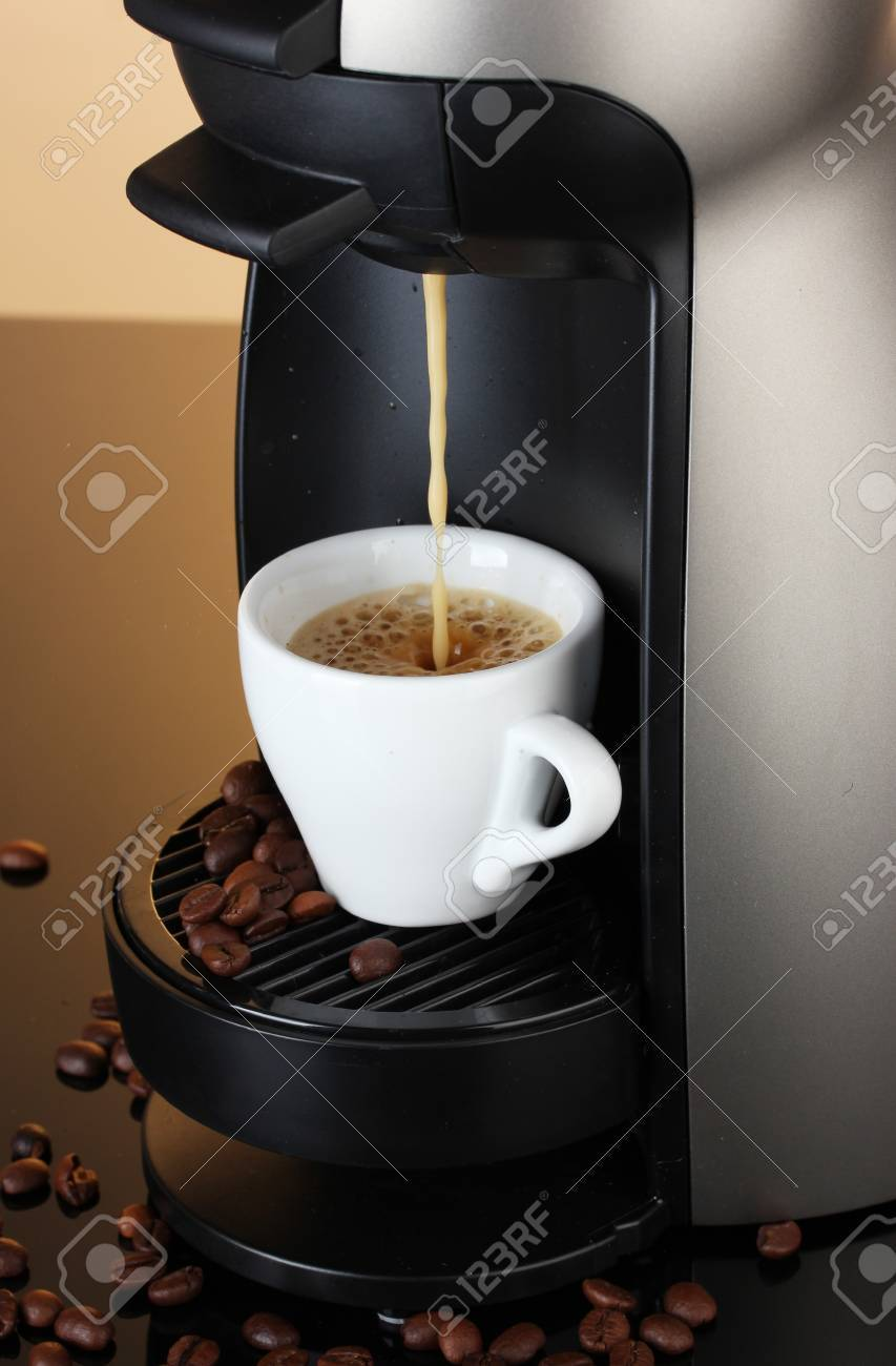 Espresso machine pouring coffee in cup on brown background Stock Photo - 12664814