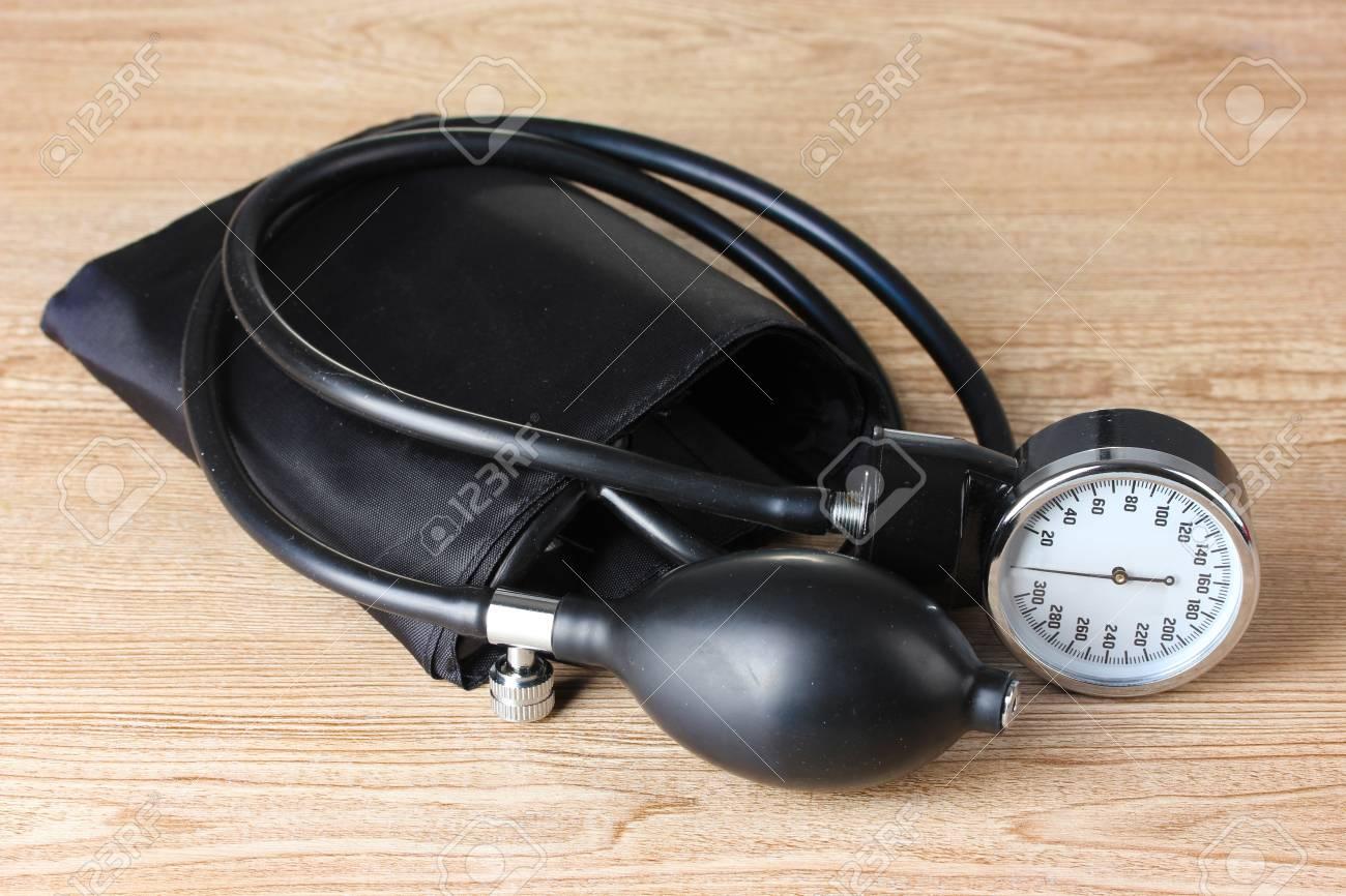 Black tonometer on wooden background Stock Photo - 12824789