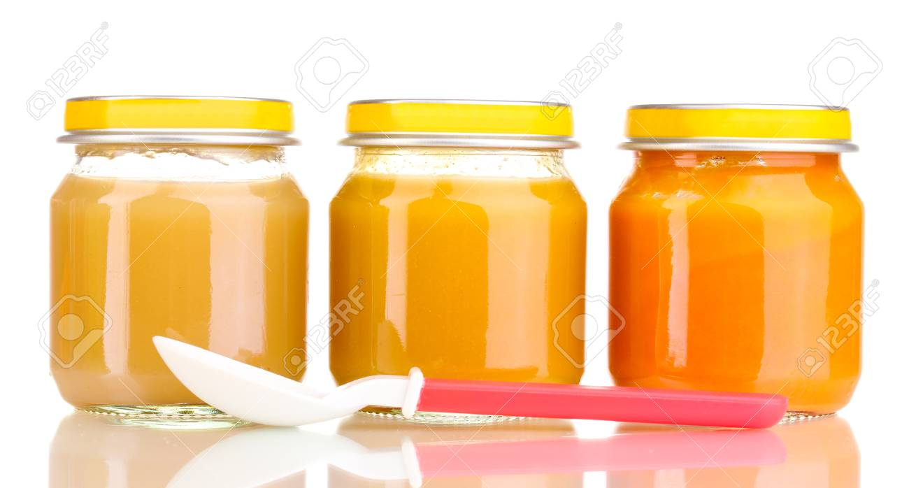 Jars of baby puree and spoon isolated on white Stock Photo - 12824944