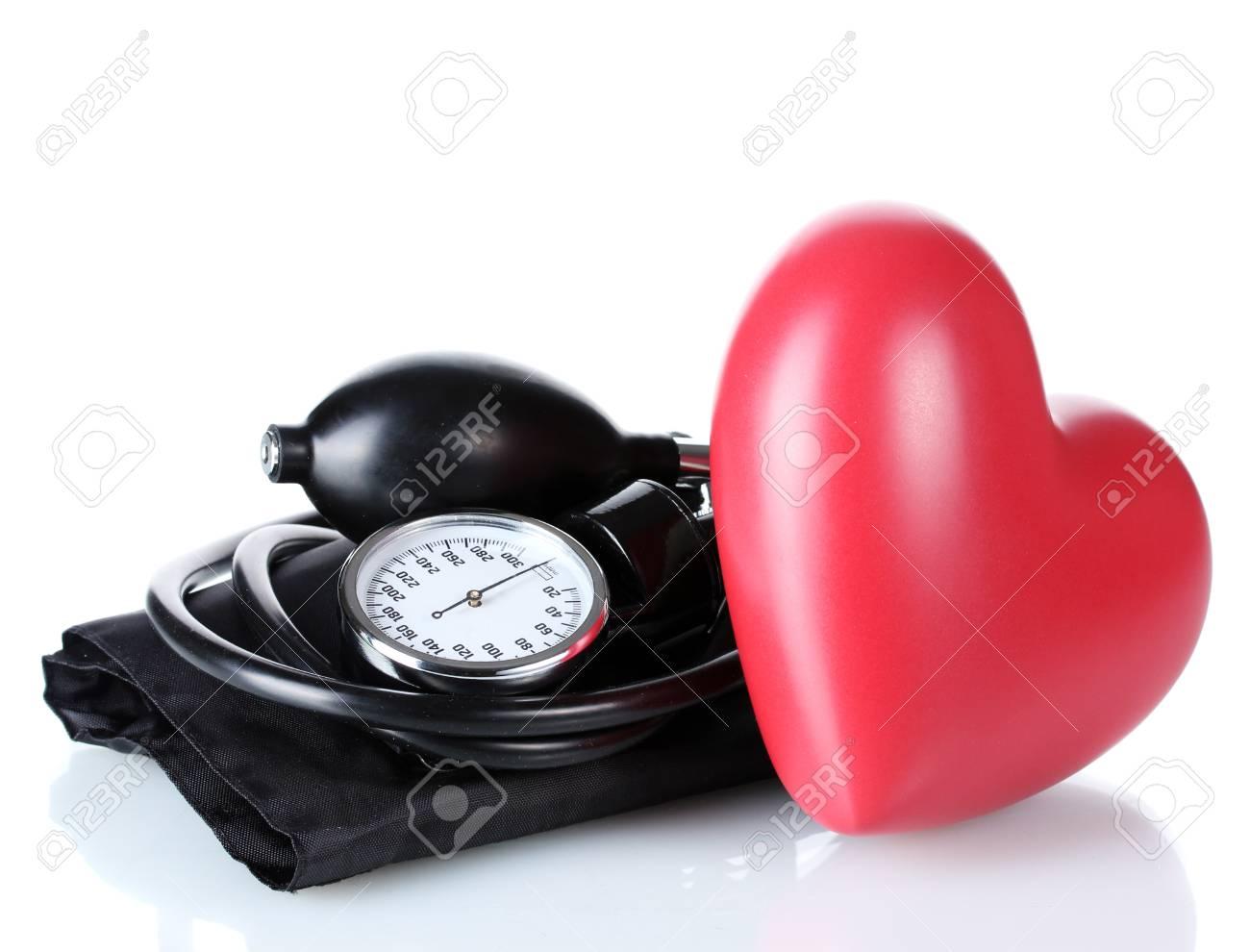 Black tonometer and heart isolated on white Stock Photo - 12913252