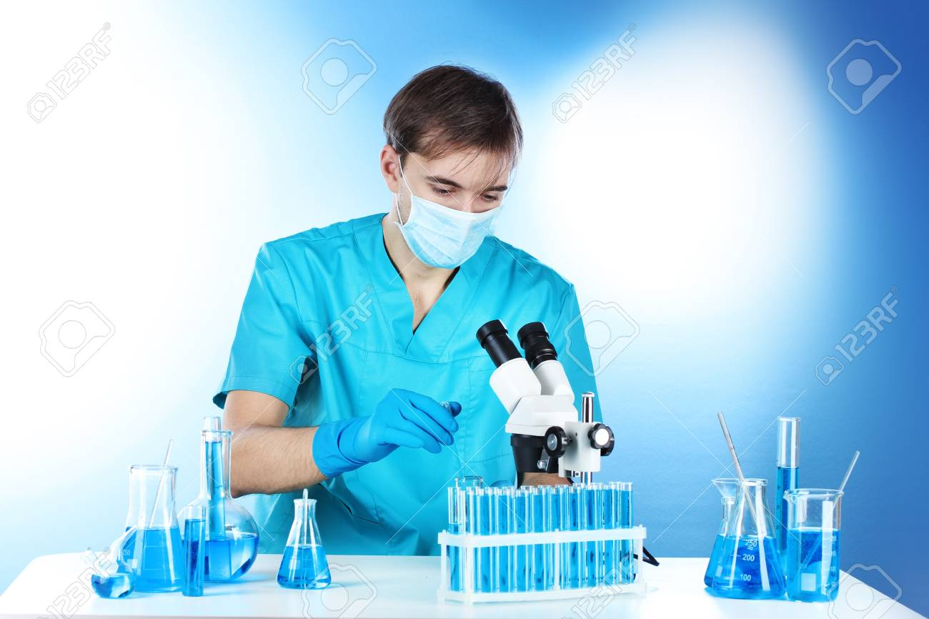 scientist in the lab working with microscope Stock Photo - 14934949