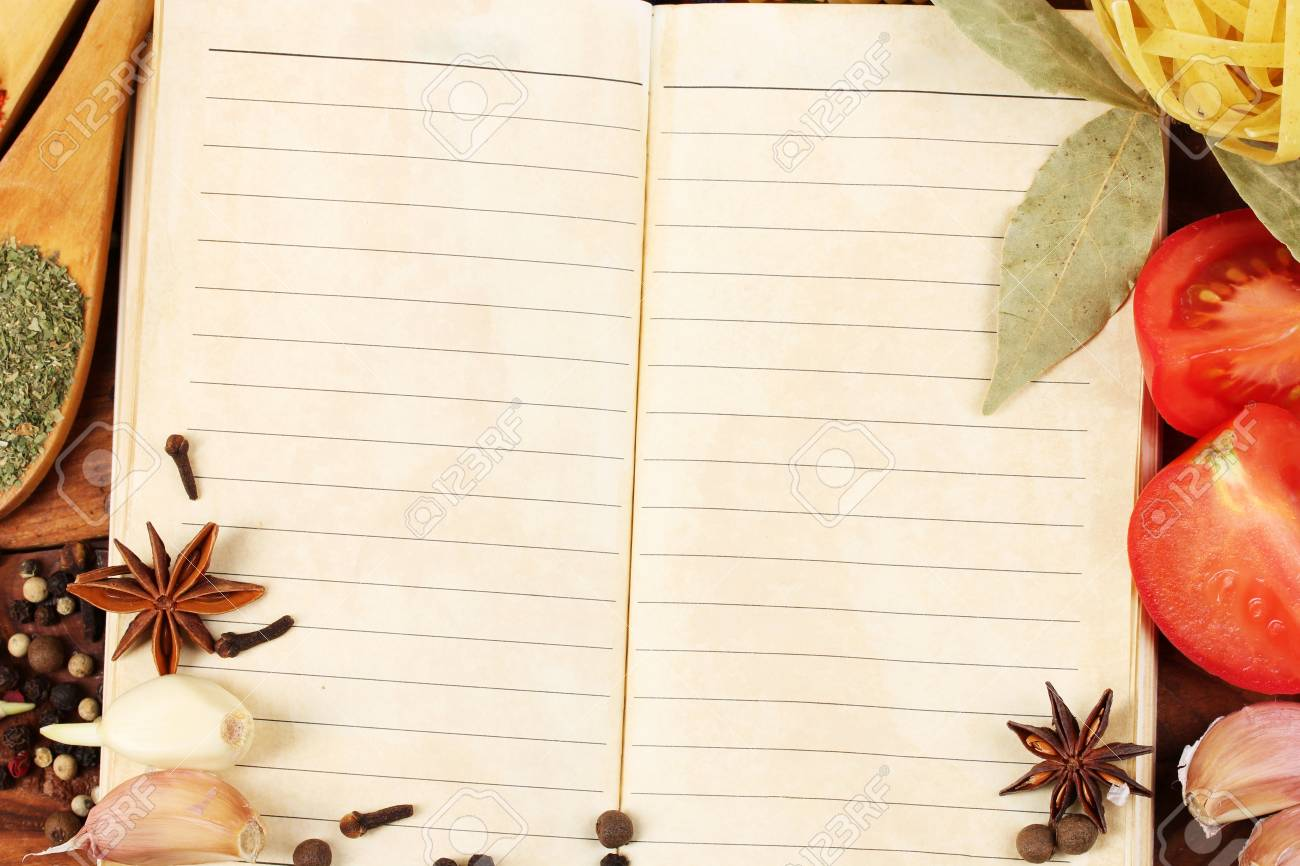 notebook for recipes and spices on wooden table Stock Photo - 13179332