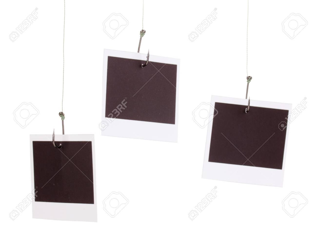 Photos on fish hooks isolated on white Stock Photo - 13223272
