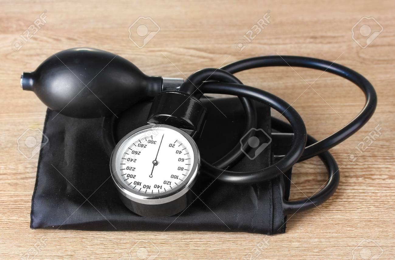 Black tonometer on wooden background Stock Photo - 13223879