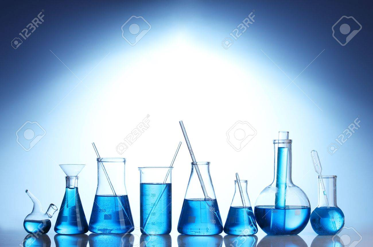 Test-tubes with blue liquid on blue background - 13267301