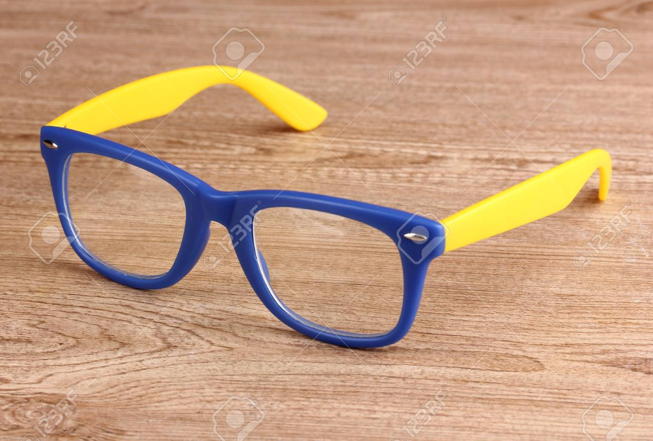 Beautiful color glasses on wooden background Stock Photo - 13265331