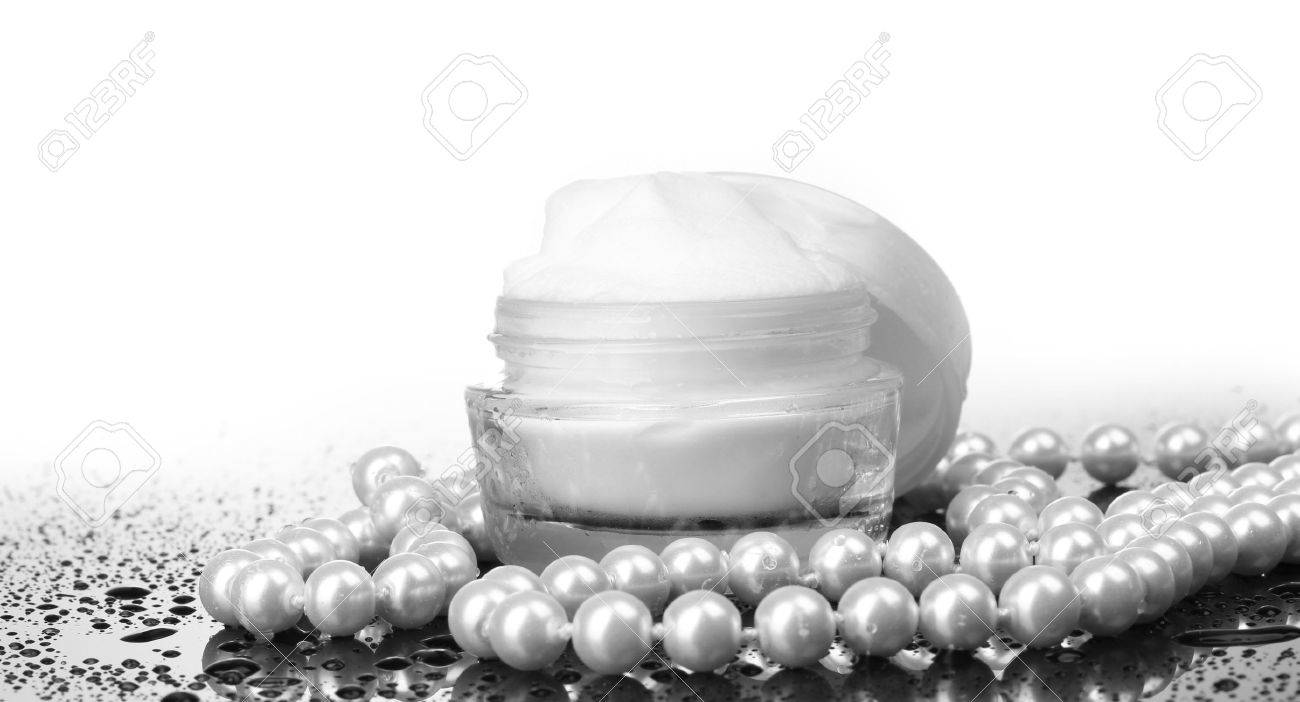 cosmetic cream on table isolated on white Stock Photo - 13374683